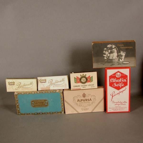 Seven advertising cardboard...