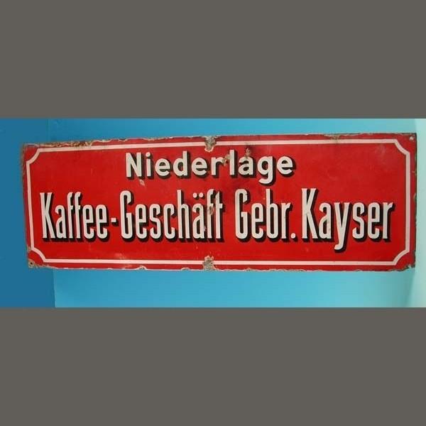 Advertising sign. Kayser...