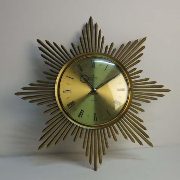 Vintage Uhr in Sonnenform....