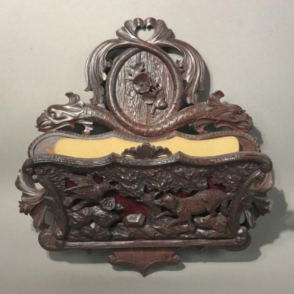 Foldable carved wood letter...
