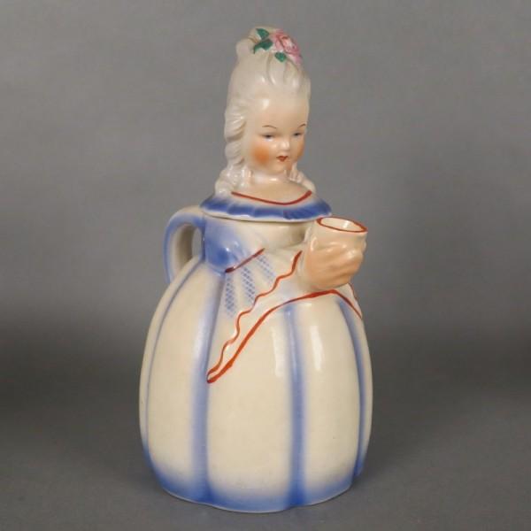 Ceramic coffee pot in form...
