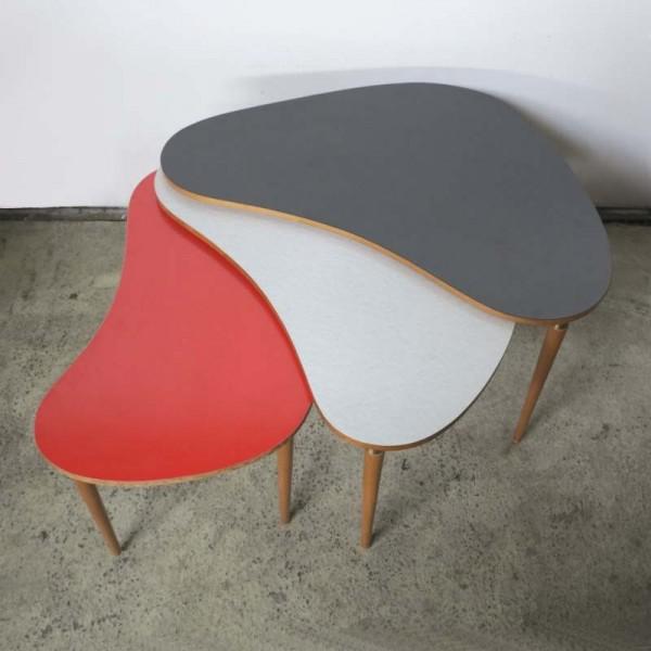 Three kidney tables in fan...